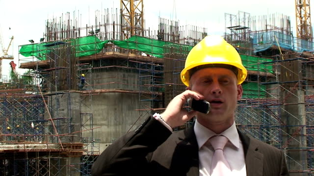 Build A builder works on a construction site. craftsman architecture stock videos & royalty-free footage