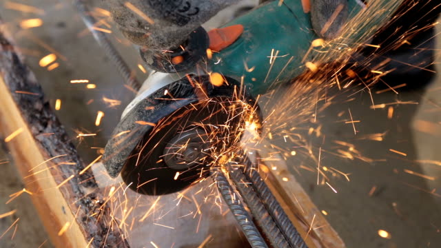 Builder cuts steel bars. video