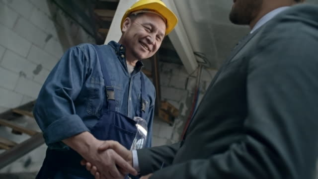 Builder Shaking Hands with Businessman video