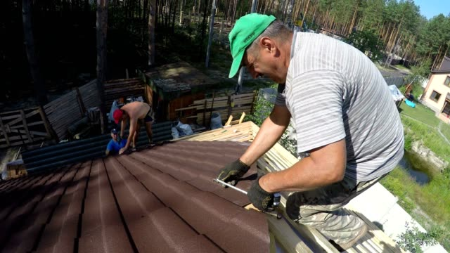 Builders build a roof. video