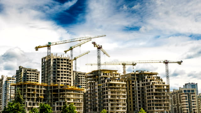 Building a house with six cranes time lapse video