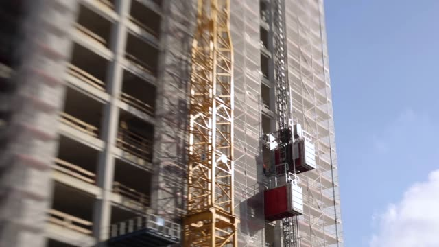 building construction elevators and construction frame - rack focus video stock e b–roll