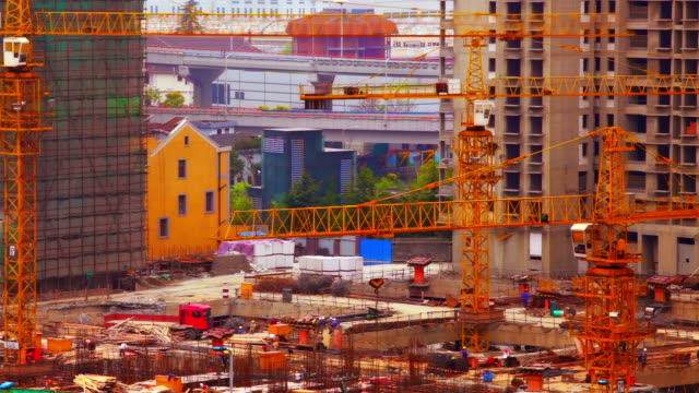 Building construction Building construction - manual workers, crane, with background building and hi-way. Time lapse. crane construction machinery stock videos & royalty-free footage