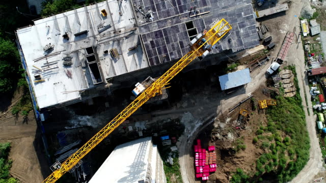 Building crane, aerial view. Construction and Industry. Building crane, aerial view. Construction and Industry. construction machinery stock videos & royalty-free footage