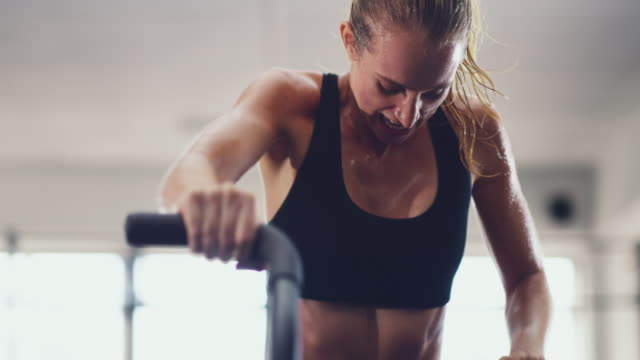 Building her stamina 4k video of an attractive young woman working out on an exercise bike in the gym exercise bike stock videos & royalty-free footage