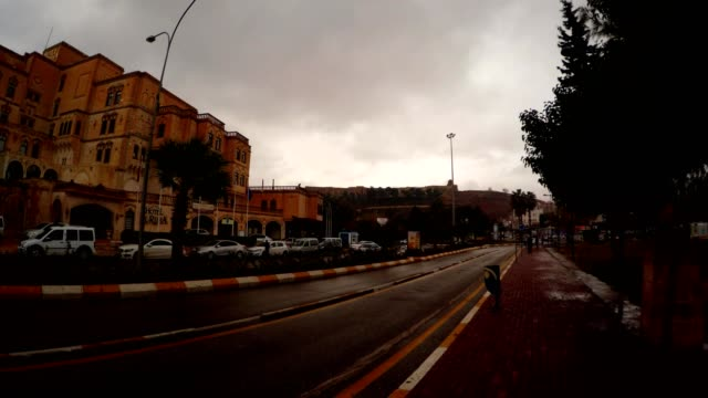 Building in Centre of Shanlyurfa Cars Drive on Asphalt Road Cloudy Evening video