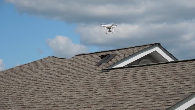 Building Inspector Uses Small Drone to Inspect Damaged Shingles on Roof video