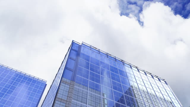 building reflection blue sky time-lapse. - risorse sostenibili video stock e b–roll
