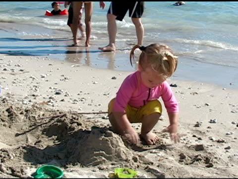 building sandcastles. - endast flickor bildbanksvideor och videomaterial från bakom kulisserna