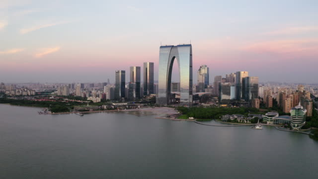 CBD buildings by the lake in Suzhou, China in the morning. CBD buildings by the lake. Aerial in Suzhou, China. china east asia stock videos & royalty-free footage