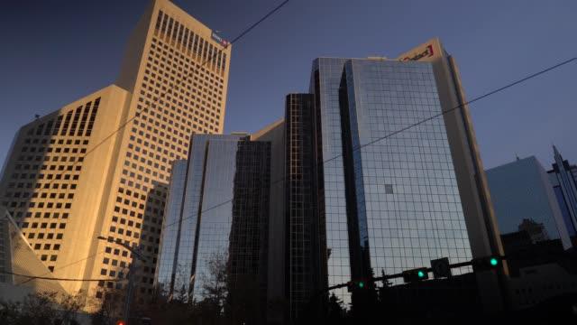 Buildings in Calgary illuminated by sunrise