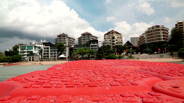 buildings on the shore of gulf of siam in pattaya, thailand - ocean front properties stock videos & royalty-free footage