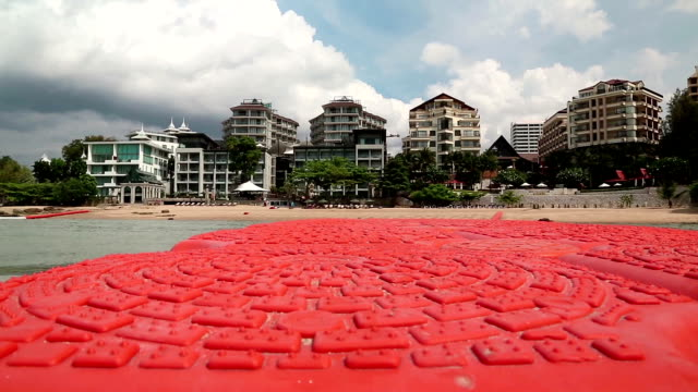buildings on the shore of gulf of siam in pattaya, thailand. view from the sea - ocean front properties stock videos & royalty-free footage