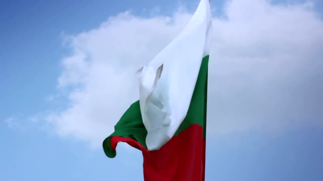Bulgarian national flag waving on flagpole in blue sky. Bulgaria video