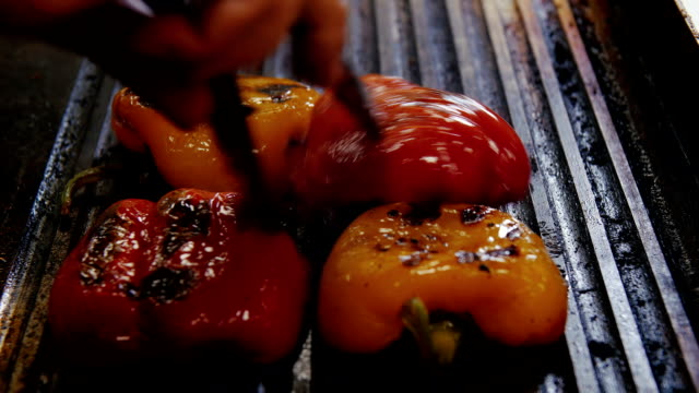 Bulgarian pepper is fried on a plate. Close-up video