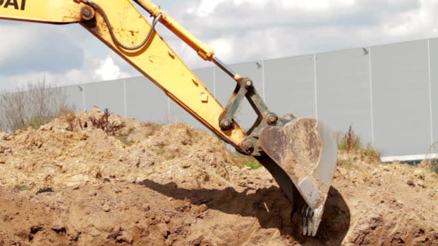 Bulldozer charging shovel with sand and transporting to pile Construction Excavator Scooping and Dumping on Dirt Pile or Gravel. Unloading Shovel Process. dump truck stock videos & royalty-free footage