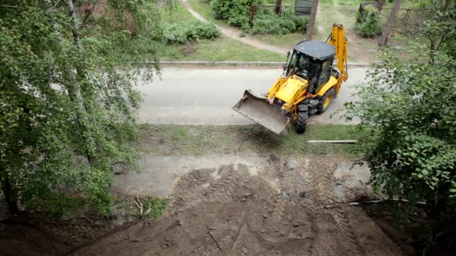 A bulldozer leaves for another construction site. A bulldozer leaves after a completion of construction work. construction vehicle stock videos & royalty-free footage