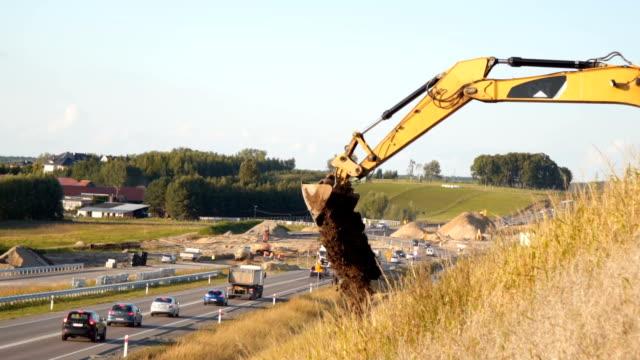 stockvideo's en b-roll-footage met bulldozer puring zand wegenbouw - shovel