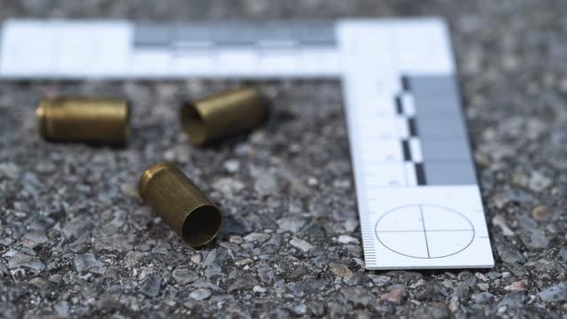 Bullet casings on asphalt