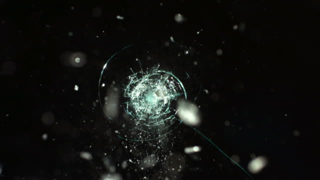 Bullet hitting safety glass, slow motion video