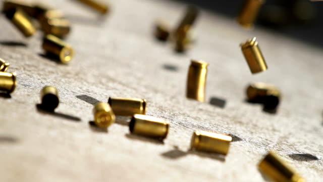bullet shells drop - стрелять стоковые видео и кадры b-roll