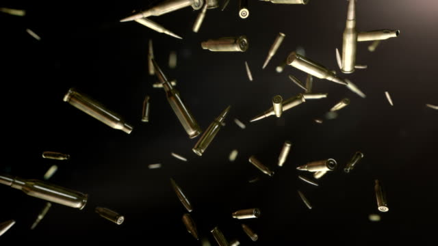 HD: Bullets flight High quality super slow motion bullets flight in dark space. gun stock videos & royalty-free footage