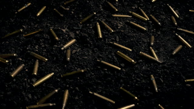 Bullets Scattered Over Ground Moving Shot video