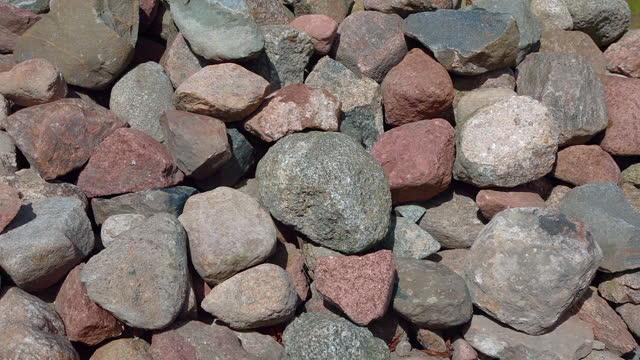 bunch of colorful granite rocks pile of cobblestones lot of pebbles
