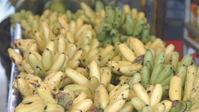 Bunch of Organic Bananas at Market Stall. FullHD video