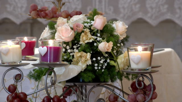 Bunch of roses with candles video