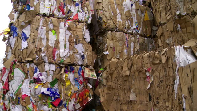 Bundles Of Cardboard Waste Tilt Up video