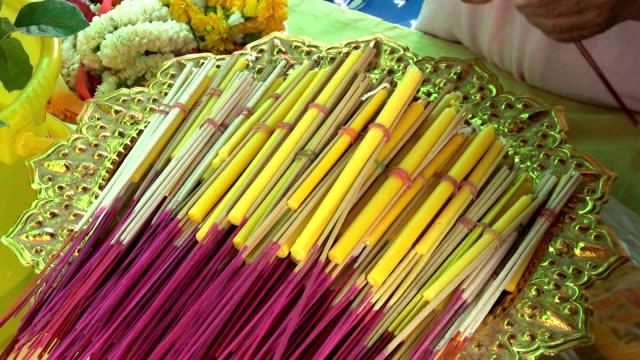 Bundling Incense Sticks At The Temple video