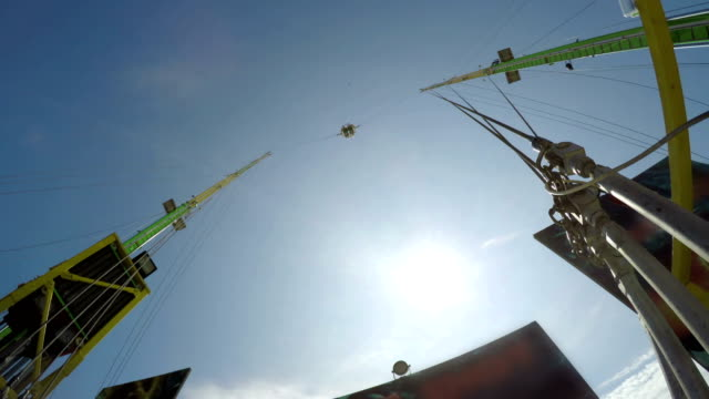 bungee ball released against sun. amusement park extreme ride - bungee jumping video stock e b–roll