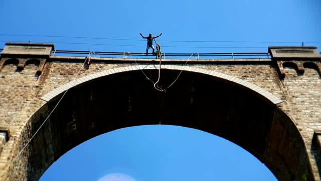 bungee jumping bunovo bridge near sofia - bungee jumping video stock e b–roll