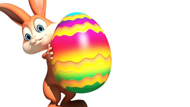bunny mit großes ei - osterhase stock-videos und b-roll-filmmaterial