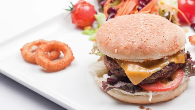 Burger on a white background Burger on a white background onion ring stock videos & royalty-free footage