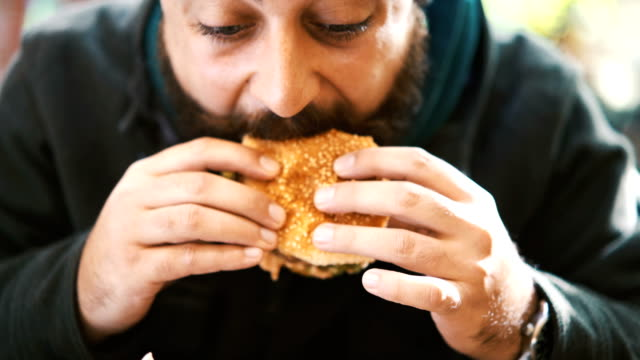 burger time. - junk food stock videos and b-roll footage