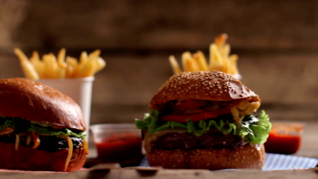 Burgers with sauce and fries. video