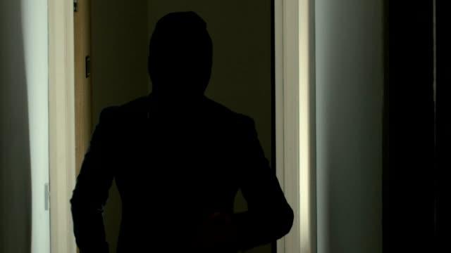 A Burglar With An Axe Moving Quietly Through A House video
