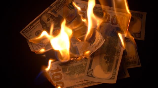 Burning 100 dollars bills video