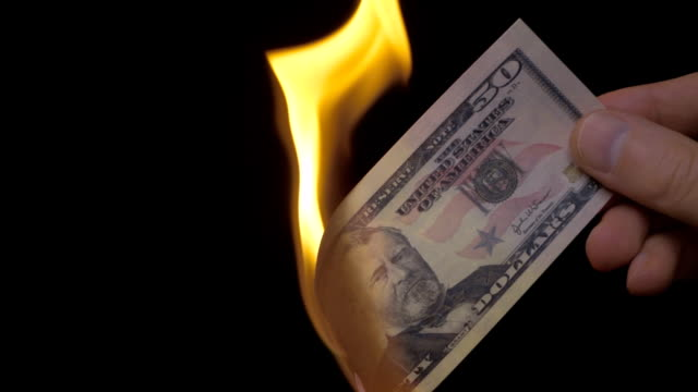 Burning bill of $ 50 on the black background. Slow mo, slo mo video