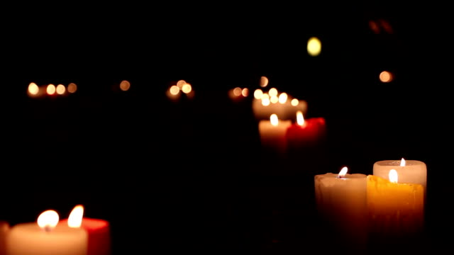 Burning candles at night outdoors video