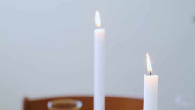 Burning candles for decoration on table at home