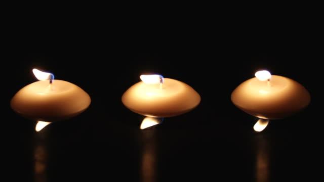 vídeos de stock e filmes b-roll de velas em blackness - três objetos