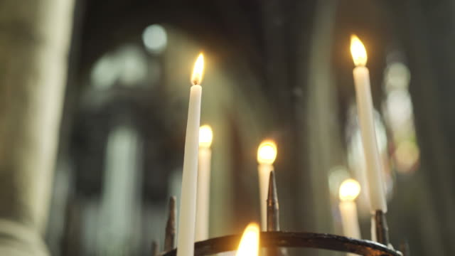 burning candles in church - gothic architecture stock videos & royalty-free footage