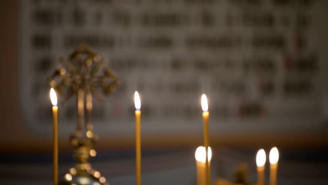 Burning candles in the Christian church video