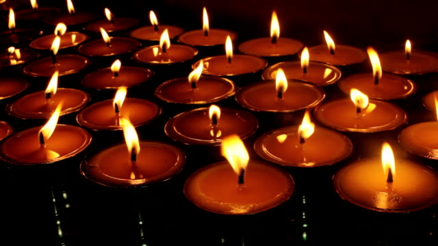 Burning candles in Tibetan Buddhist temple video
