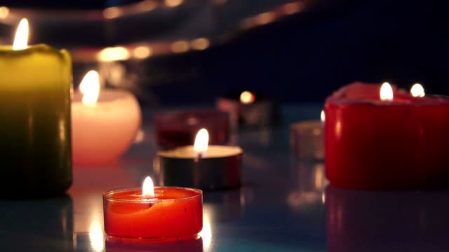 Burning candles on a black background video