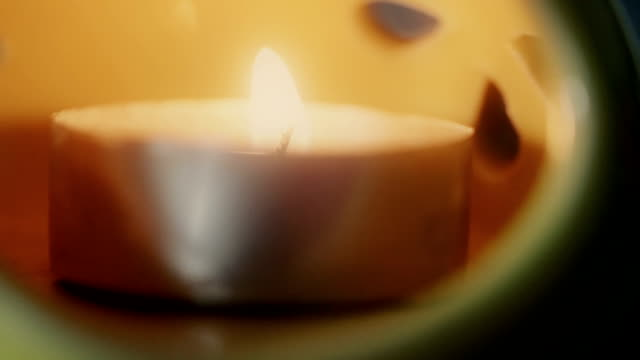 Burning candles with aromatherapy lamp. video