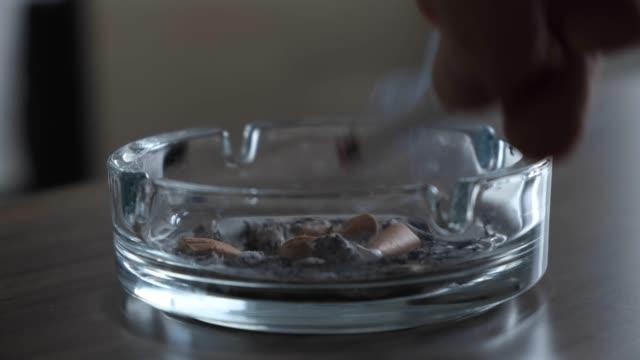 burning cigarette - sigaretta video stock e b–roll